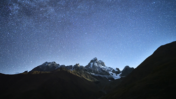 Lay beneath the mountain stars away from civilization! Dream big and dream high with the Mountain Stars wallpaper.