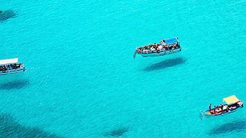 Salty water and cool breeze, it must be the Blue Sea! Cruise on the turquoise waters of the Blue Sea wallpaper and you'll start to feel the vacation in the air. Combine the Blue Sea wallpaper with any color set and let yourself drift on the waves.
