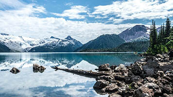 Feel the freshness of outdoors from your PC with the Mountain Lake wallpaper. If you like mountains and lakes, get this free Mountain Lake wallpaper on your homepage.