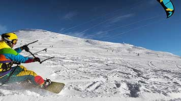Grab the kite and don't let go, the wind is just perfect! If you want to experience the fun of snow kiting without the extreme cold and a lot less money, then set the Snow Kiting theme on your homepage and let the adventure start!